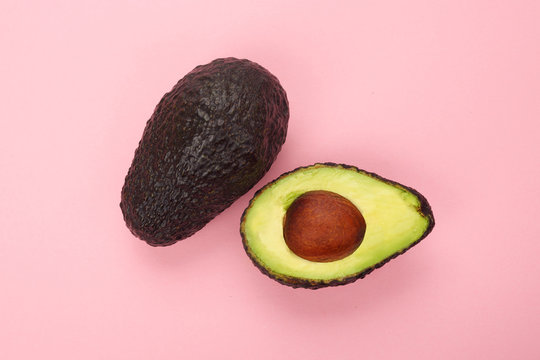 Top view of a ripe sliced avocado isolated