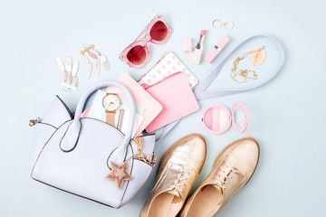 Set of Feminine accessories  with handbag, watch, note, beauty products and shoes. Flat lay, top view. Fashion concept in pastel colored