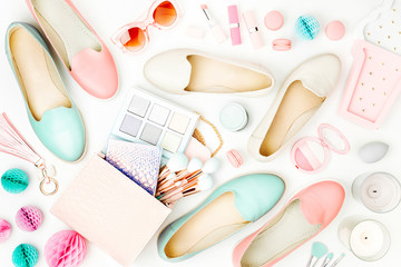Flat lay of female fashion accessories, shoes, makeup products and handbag on pastel color background. Beauty and fashion concept Wall mural