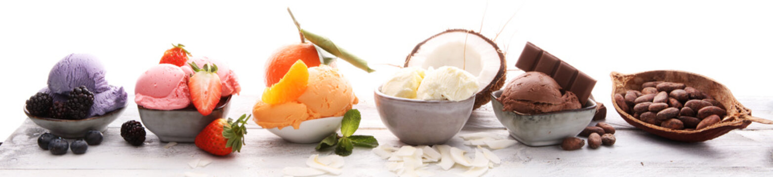 Set of ice cream scoops of different colors and flavours with berries, nuts and fruits