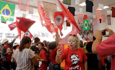 Supporters of former Brazil president Luiz Inacio Lula da Silva shout slogans before the Supreme Court issues its final decision about his habeas corpus plea, at the metallurgic trade union in Sao Bernardo do Campo
