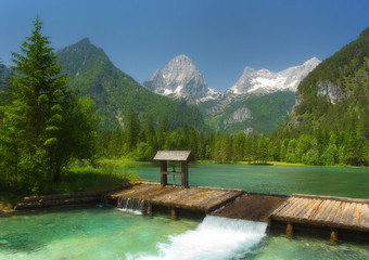 A mountain lake with water gate and peaks on background, Totes Gebirge, Austria