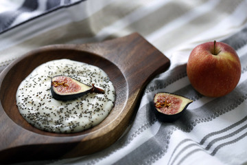 Yogurt with chia seeds and fig served in bowl