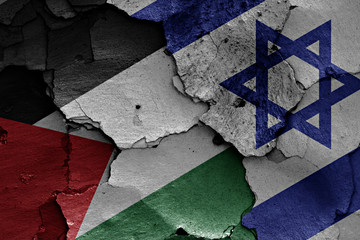 flags of Palestine  and Israel painted on cracked wall