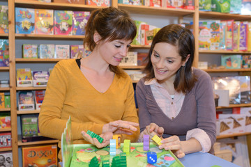 homosexual couple reviewing games in toy store