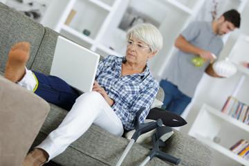 senior woman with laptop injured