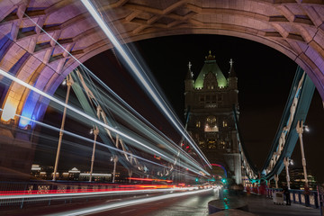 Light trails on Tower bridge at night, London, England