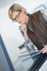female technician while doing printer maintenance