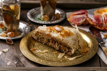 Close view of bastilla pie on copper plate
