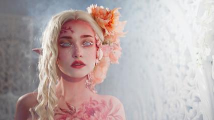 Mysterious elf girl. Creative pink makeup. Elvish ears.