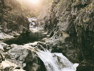 Scenic view of water flowing in Yuba River amidst rock formations