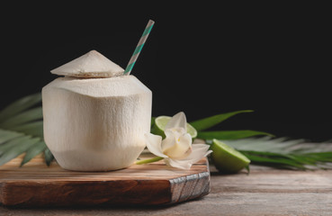 Fresh coconut drink in nut on wooden board