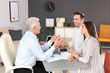 Human resources commission conducting job interview with applicant in office