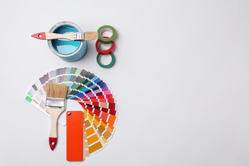 Set of decorator's tools on light background, flat lay
