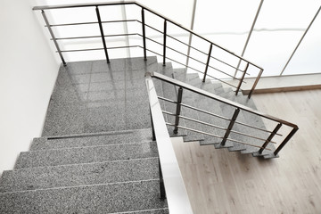 Stone stairs with metal railing indoors, view through CCTV camera