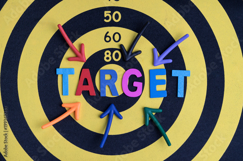 business aiming target or goal plan for success concept multi colorful magnet arrows pointing at