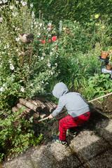 Boy playing at garden