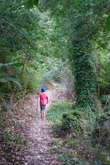 Boy walking on forest path, Crete, Greece