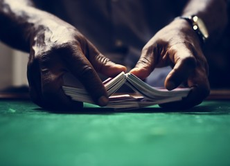 Man mixing a deck of cards