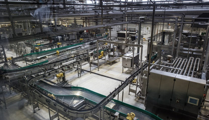 Brewery factory production line. Conveyor, pipeline and other industrial machinery, no people
