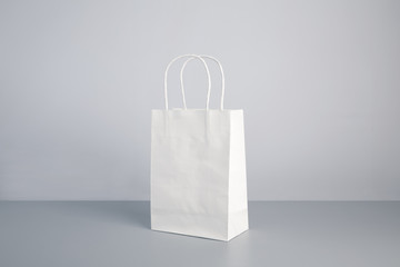 white color paper bag on table