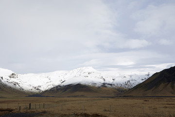 Scenic view of snowcapped mountain against cloudy sky at Iceland