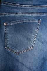 The texture is denim with a pocket