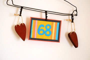 Number 68 anniversary celebration card against a bright white background