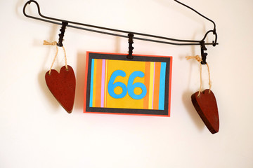 Number 66 anniversary celebration card against a bright white background