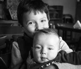 Boy with baby brother, Greece