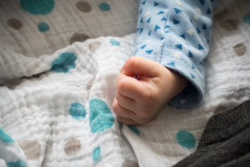 Newborn baby on bed