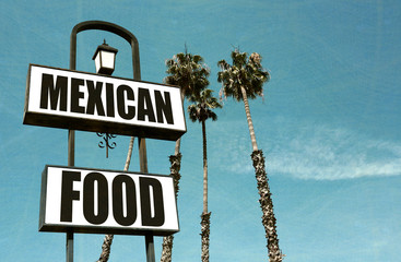 aged and worn Mexican food sign with palm trees