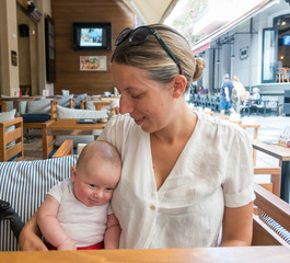 Mother with baby at restaurant