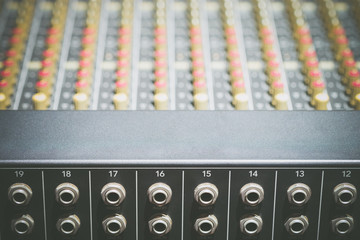 TRS inputs, outputs on back panel of professional audio equipment