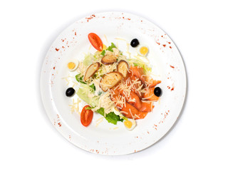 Vegetable salad fish on a white plate