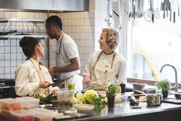 Chefs working together in kitchen at restaurant