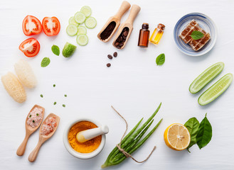 Natural herbal skin care products. Top view ingredients cucumber ,aloe vera ,lemon ,honey ,himalayan salt and tomato on table concept natural face moisturizer. Facial treatment preparation background.