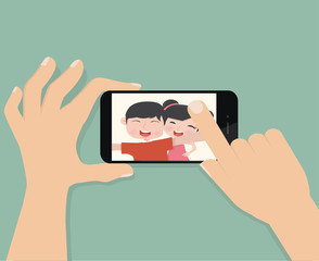 hand hold smartphone and touch  selfie