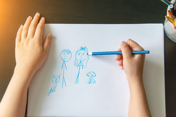 child's hand draw a pencil