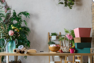 Photo of florist's room with vase of flowers, marshmallow