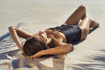 Fashion woman sunbathing on beach