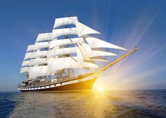 Sailing ship and sun rays. Sailing. Yachting