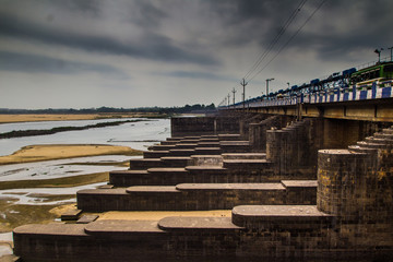 dam barrage in durgapur city landscape with flood gates closed clowdy scene HDR
