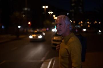 Senior man waiting on city street