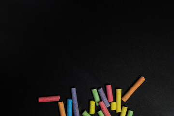 Colored crayons on a blackboard.