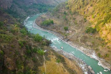 Aerial view of small suspension bridge over the Kali Gandaki river between Kushma and Balewa in Nepal