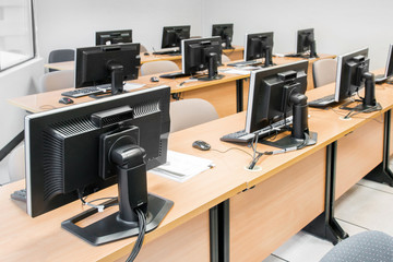 Empty computer room neatly placed for student.