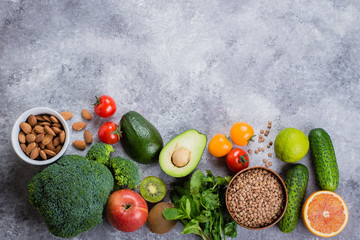 Healthy Food Clean Concept. Raw fruits, Vegetables, Nuts, Cereals on Concrete Stone Table Background.