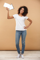 Full length portrait of an excited young african woman