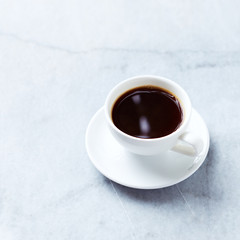 Cup of Black Coffee on gray marble background